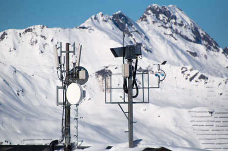 airwaves: Communication tower with lifecam, satellite dishes and aerials in skiing resort in Montafon, Austria