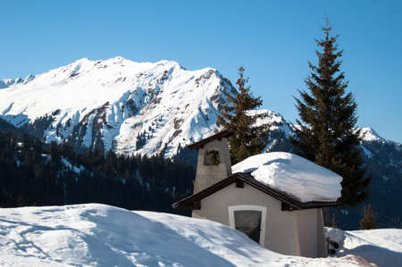 small chapel in skiing resort in the mountains of Montafon, Austria photo