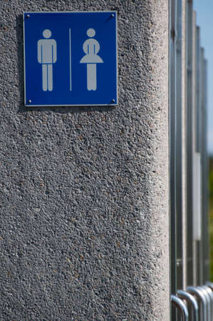 Modern unisex public toilets - sign with doors in a row Stock Photo - 14331566