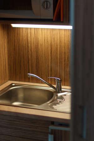 Modern minimalist kitchen built-in cupboard in an apartment photo