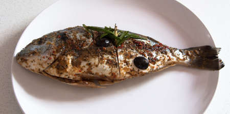 Gilthead Seabream fish marinated, ready for BBQ photo