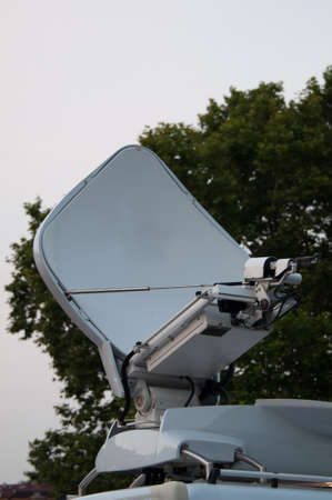 White broadcast truck recording and broadcasting a live event photo