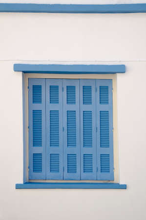Greek blue window shutters photo