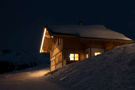 Beautiful skiing hut at  night Stock Photo