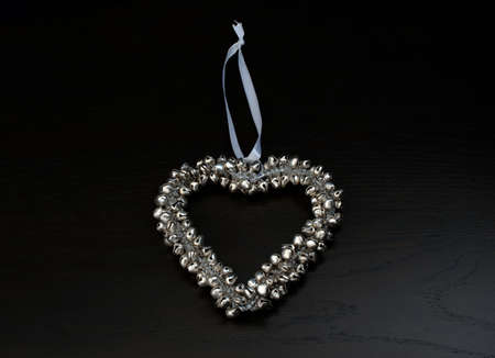 silver bells: decoration  silver bells forming a heart Stock Photo