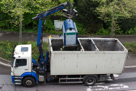 A truck is emptying recycling glass containers in Germany photo