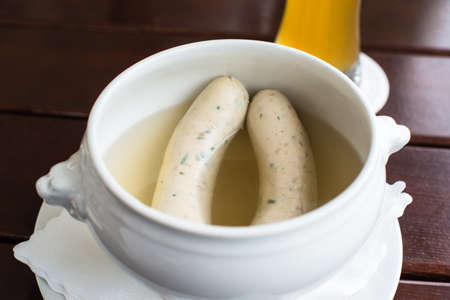 weisswurst: Weisswurst - typical Bavarian white sausages with Hefeweizen (wheat beer)
