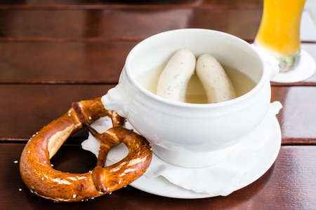weisswurst: Weisswurst - typical Bavarian white sausages with Pretzel and Hefeweizen (wheat beer)
