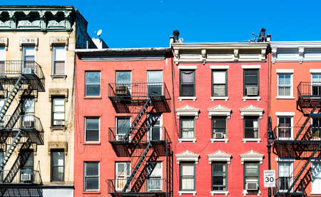 fire laddesrs at beautiful colorful house facades downtown in New York