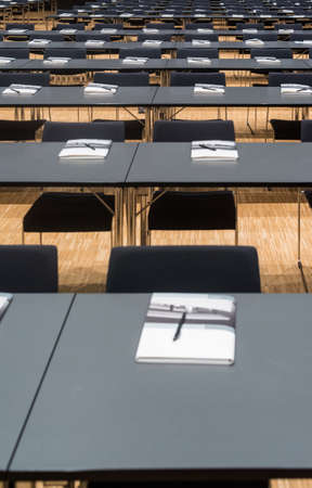 Closeup of a large empty conference room with handouts, papers and pens before meeting Stock Photo
