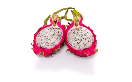 Two halves of pitahaya or dragon fruit with shadow and reflection on white background photo