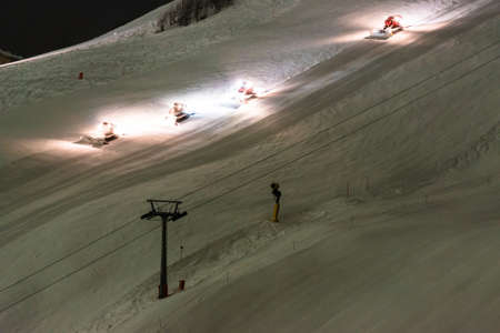 groomer: Snow groomer equipment at night Stock Photo