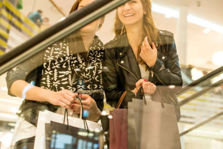 Two attractive girls shopping photo