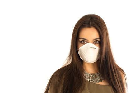 Attractive woman wearing a protective mask 版權商用圖片