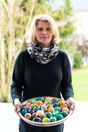 woman presenting easter eggs photo