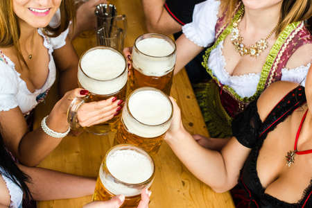 prost: Bavarian girls drinking beer