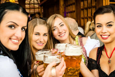 prost: Girls drinking beer Stock Photo