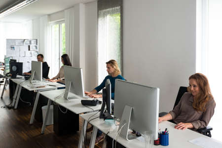 Young team working at desks in stylish office