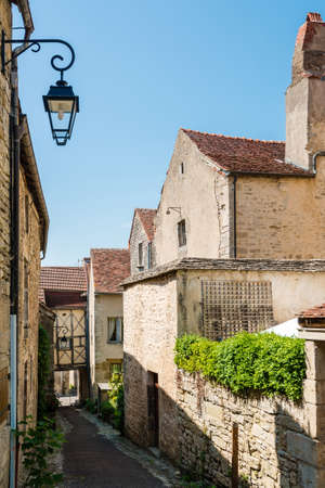 chocolat: Beautiful street in Flavigny-sur-Ozerain a little village in Burgundy, France that served as setting for the movie Chocolat by Lasse Hallstroem Stock Photo