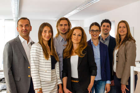 executive woman: Portrait of a business team inside the office, all rather young - might be a startup company Stock Photo