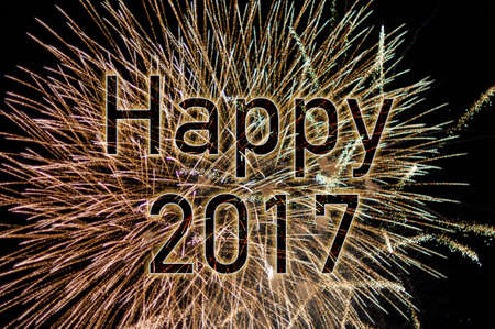 Happy New Year 2017 with colorful sparklers.