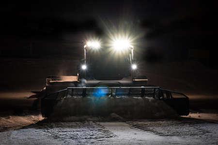 snowcat: Snowcat preparing a slope at night in high mountains at skiing resort