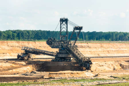 rwe: One of the worlds largest bucket-wheel excavators is digging lignite (brown-coal) in of the worlds deepest open-pit mines in Hambach in the Ruhr area in Germany. Stock Photo