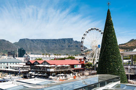 Cape Town, South Africa - November 15, 2016: Christmas preparation at the famous Victoria and Alfred (V&A) Waterfront of Cape Town with the Table Mountain in the background: The tree is erected and about to be richly decorated for the forthcoming Christma
