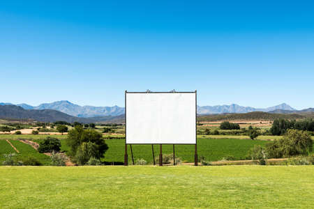 customizable: Panoramic view of big blank billboard in nice scenery Stock Photo
