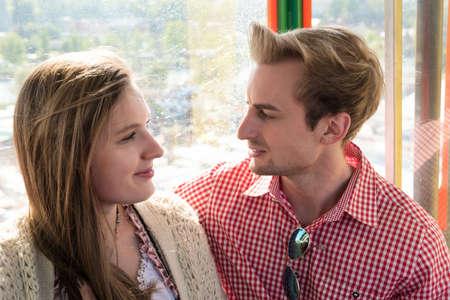 ferriswheel: Young couple inside a Ferris wheel on Oktoberfest