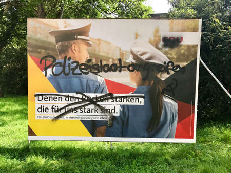 parliamentarian: Vandalized CDU billboard for the German Parliamentary Elections Editorial