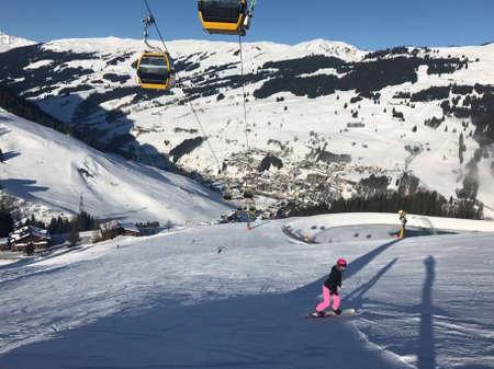 Female snowboarder on piste