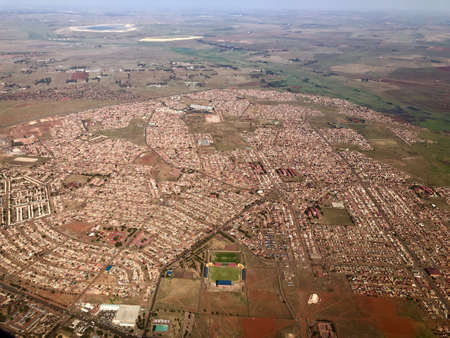 Approaching Johannesburg in South Africa by plane: The city began as a gold-mining settlement and is now a major financial and industrial city of Africa.