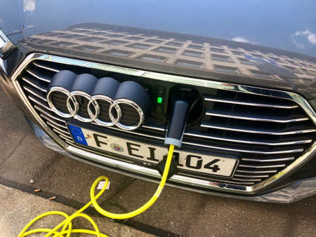 An Audi A3 e-tron plug-in hybrid car charging in the streets of Leipzig, Germany. 에디토리얼