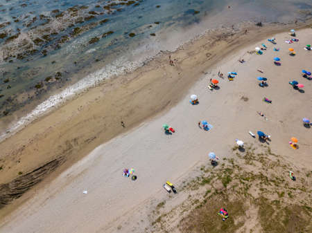 Aerial view of unidentifiable people enjoying summer at the beach of Grado in the province of Gorizia at the Northern Adriatic Sea 스톡 콘텐츠