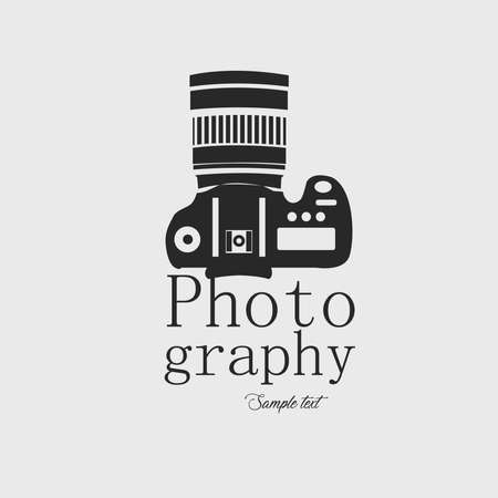 Icon for professional photography. Camera and text in dark gray on white background vector image. Ilustrace