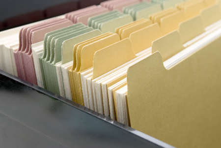 index card: Closeup of an opened box of index cards.  Black box, white cards with dividers coloured pink, green and yellow.