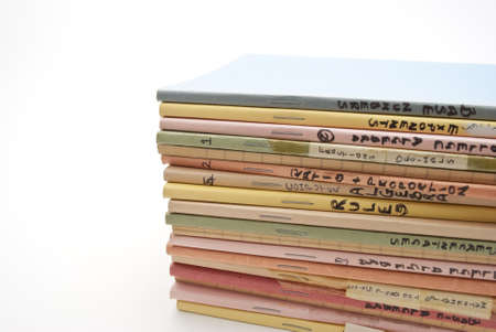 labeled: A stack of old school or college exercise books, labeled with various mathematical subjects.  Copy space to left.  White background