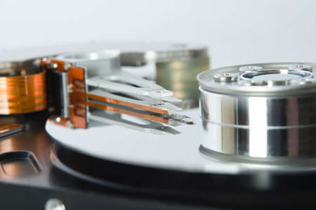 Close up (macro) of an opened hard disk mechanism/ Stock Photo - 9321745