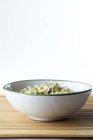 beansprouts: A bowl of mung beansprouts on a bamboo