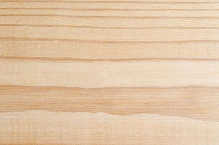 A light pine wood background with a striped grain providing natural section breaks.  Slightly rough texture and imperfections at 100% view.