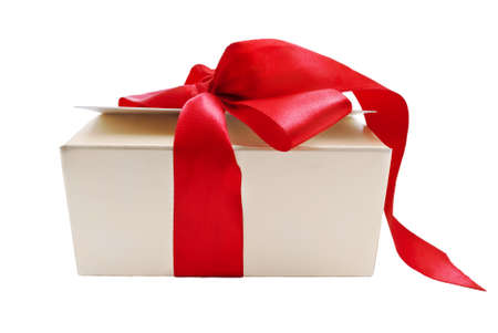 trailing: A gold gift box with tied red ribbon trailing onto the ground, isolated on white background