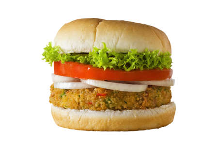 A cheese-free vegetarian burger made from vegetables and breadcrumbs, stacked with onion rings, slice of tomato and curly lettuce, in a bap.  Isolated on white.