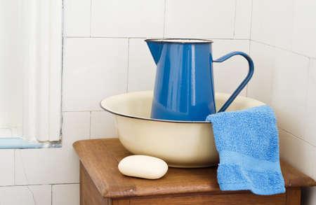 wash basin: A simple rustic, retro bathroom scene