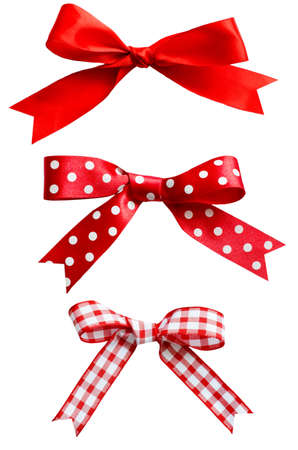 gingham: Three types of isolated red ribbon bows on white background.  One plain, two patterned with polka dots and checks. Stock Photo
