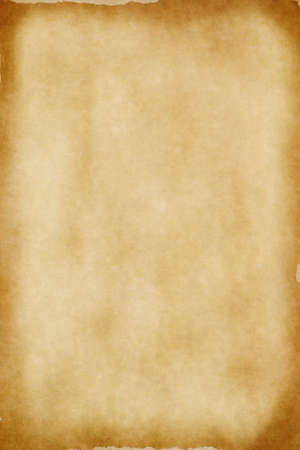 patchy: A sheet of yellowed. patchy parchment paper with darker, aged brown torn edges for background texture and copy space. Stock Photo