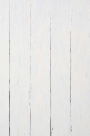 tongue and groove: A badly painted patchy piece of old white wood planking that appears dilapidated, chipped, marked and worn.   Stock Photo