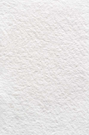 bumpy: A rough texture background of absorbent white watercolour (watercolor) paper.