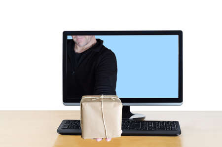 A delivery man extending his arm through a computer screen Stock Photo - 17385004