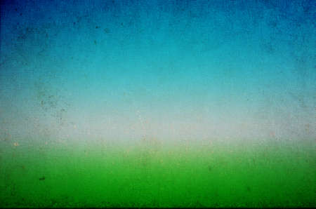 grubby: A grungy, grubby, stained and marked old  woven texture resembling a painted impressionistic grass and sky landscape.  Bright green in lower frame, rising to cyan and then blue at the top of frame.